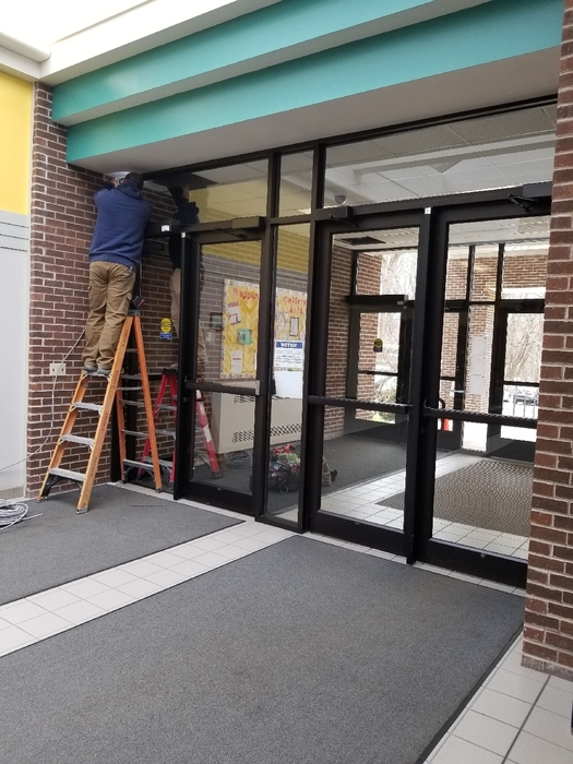 Electricians working on the new front doors